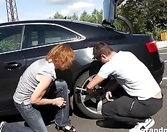 Grandma gets fucked hard outdoors after an auto repair