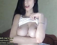 Tiny brunette with big tits
