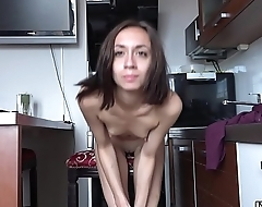 Thin young Susan spread her legs in the kitchen