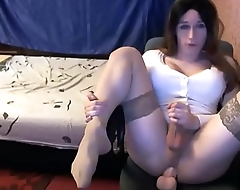 Sexy Tranny In Stockings Masturbating With A Dildo Up Her Asss