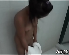 Concupiscent oriental bimbo fondles her wet cunt and gives an oral job
