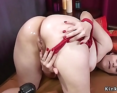 Anal fingered and toyed brunette slave