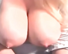 Sexy blonde bimbo breast pumps her perfect huge boobs...